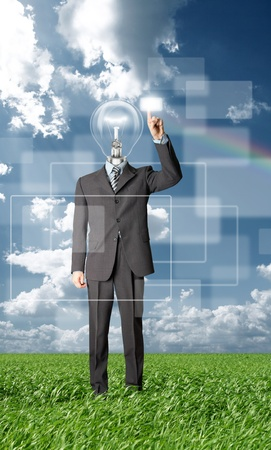 full length businessman with lamp-head push the button on virtual touch pad outdoors Stock Photo - 9094213