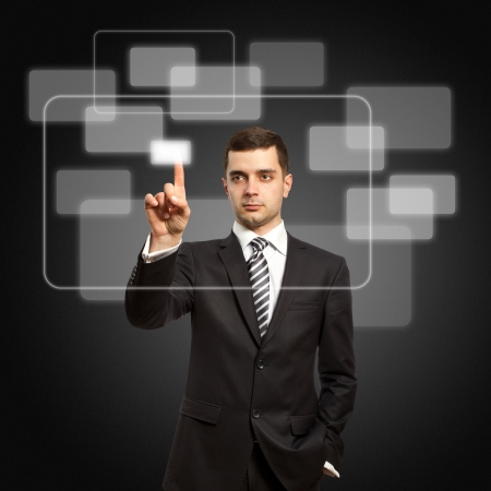 businessman push the button on virtual touch pad