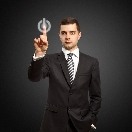 businessman push the button on virtual touch pad Stock Photo - 9094357
