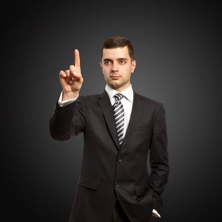 businessman push the button on virtual touch pad Stock Photo - 9094365