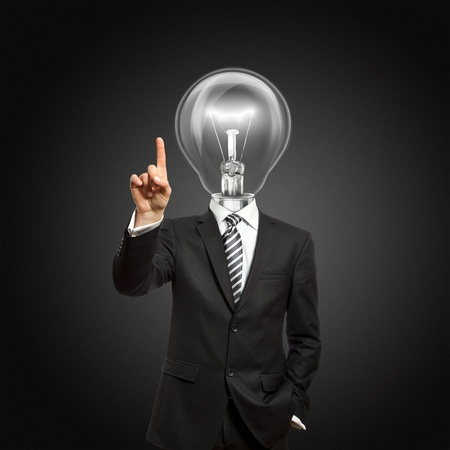 businessman with lamp-head push the button on virtual touch pad photo