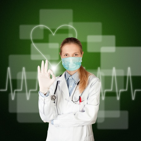 doctor woman with electrocardiogram on touch screen photo