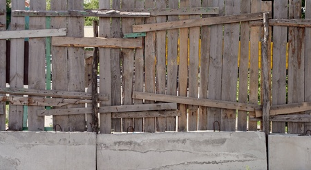 old weathered grunge fence outdoors with lumber photo