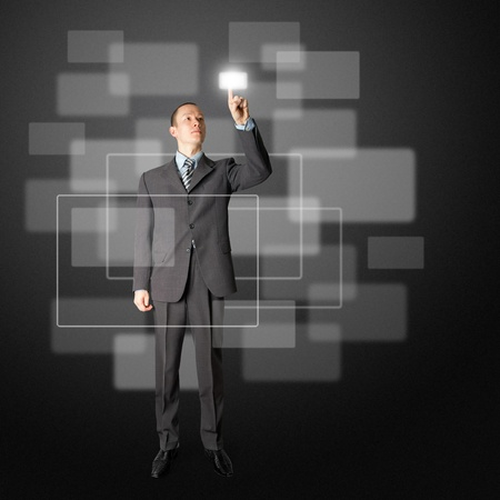 full length asian businessman push the button on virtual touch pad Фото со стока