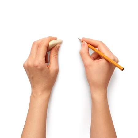 erasing: human hands with pencil and erase rubber writting something Stock Photo