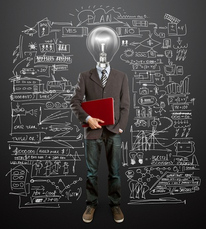 male in suit with lamp and laptop in his hands have got an idea photo