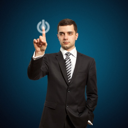 businessman push the button on virtual touch pad Stock Photo - 9233616