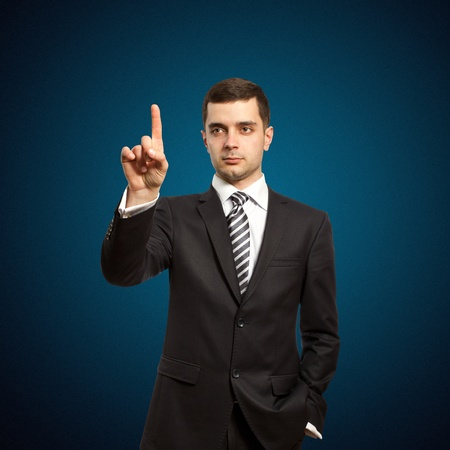 businessman push the button on virtual touch pad Stock Photo - 9233619