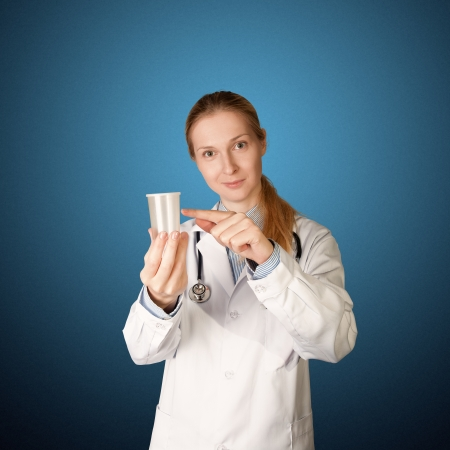 embryology: doctor woman with cup for analysis - urine, sperm Stock Photo