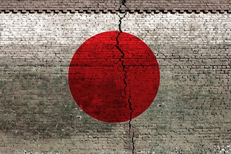 cracked brick wall as Japan flag, symbolize the recent earthquake photo