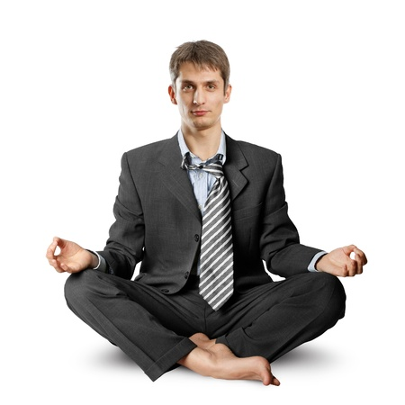 businessman in lotus pose meditating at the office Stock Photo - 9391647