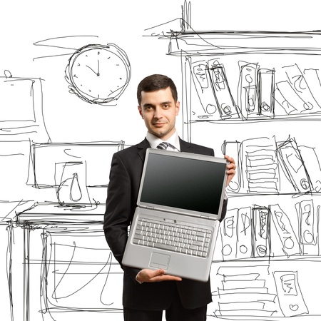office space: businessman with open laptop in his hands, smiles at camera
