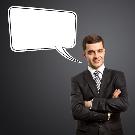 male in suit with crossed hands and thought bubble, looking on camera Stock Photo - 9391746