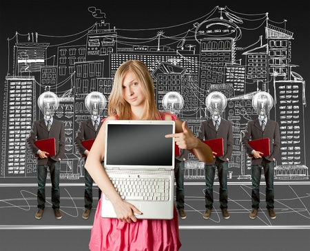 woman and lamp head businesspeople with red laptop in his hands Stock Photo - 9391668