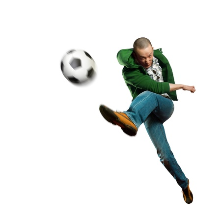 soccer kick: asian soccer player on training, kick the soccer ball Stock Photo