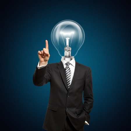 businessman with lamp-head push the button on virtual touch pad Stock Photo - 9461462