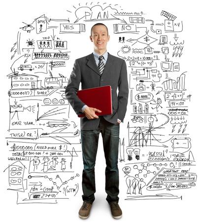 laptop asian: empresario masculino en traje con port�tiles en sus manos, mirando a la c�mara Foto de archivo