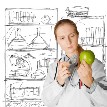 scientist woman does injection to an apple, isolated on different backgrounds photo