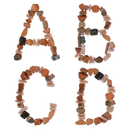collection of letters woth clipping path of ocean stones close-up photo