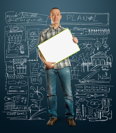 asian male with write board in his hands isolated against different backgrounds Stock Photo - 9563589
