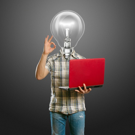 lamp-head male with laptop in his hands shows OK Stock Photo - 9564071
