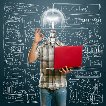 lamp-head male with laptop in his hands shows OK Stock Photo - 9712295