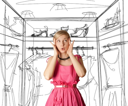summer clothing: surprised girl in pink, looking up, with open hand Stock Photo