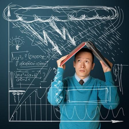 hides: young asian businessman hides under the laptop Stock Photo
