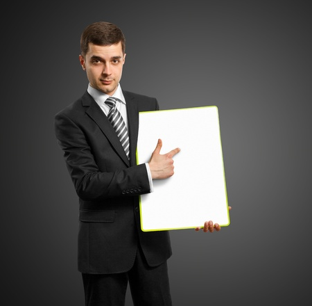 businessman holding empty write board in his hands photo