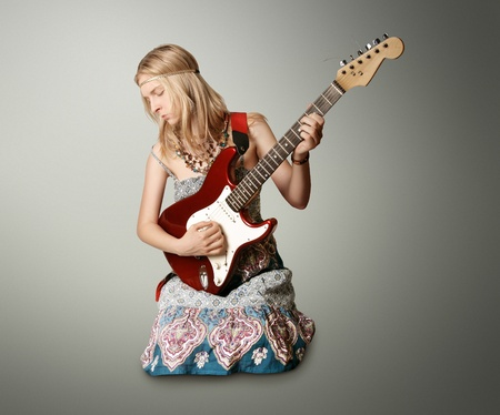 hippie girl with the guitar isolated on white background photo