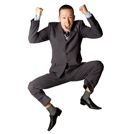 Happy businessman jumping in air isolated on white background photo