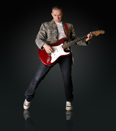 punk man with the guitar isolated on white background photo