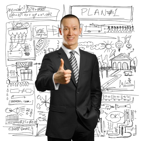 asian businessman in black suit shows well done against different backgrounds Stock Photo - 9712573