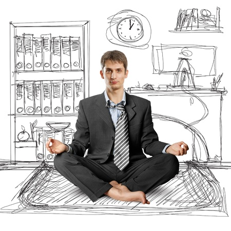 businessman in lotus pose meditating at the office Stock Photo - 9712690