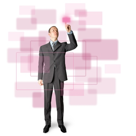 asian business: full length asian businessman push the button on virtual touch pad Stock Photo