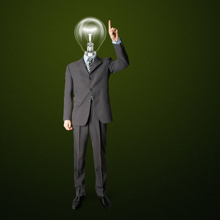 full length businessman with lamp-head push the button on virtual touch pad photo