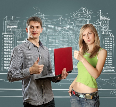 man with laptop in his hands and woman shows well done photo