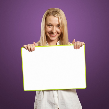 happy businesswoman holding blank white card in her hands photo