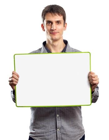mâle avec le conseil d'écriture dans les mains isolés sur différents fonds