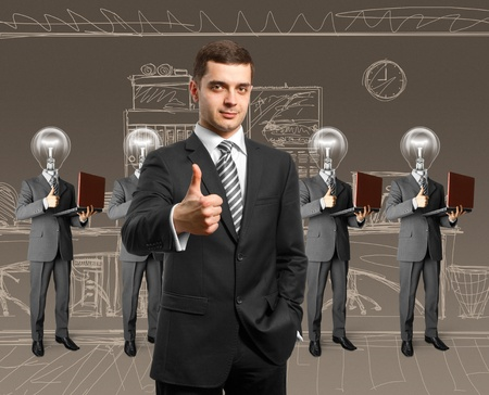 lamp head business people with man shows well done photo