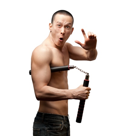combative: funny muscular shaolin monk with nunchaku in his hands