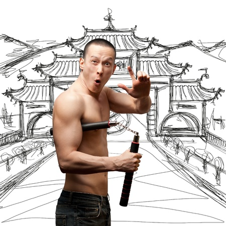 funny muscular shaolin monk with nunchaku in his hands Stock Photo - 9955046