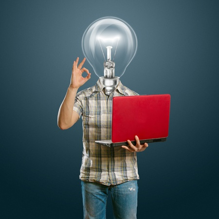 lamp-head male with laptop in his hands shows OK Stock Photo - 10120129