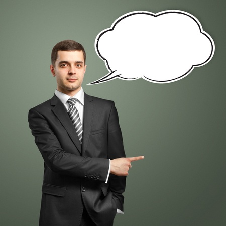 male in suit with showing finger and speech bubble, looking on camera photo