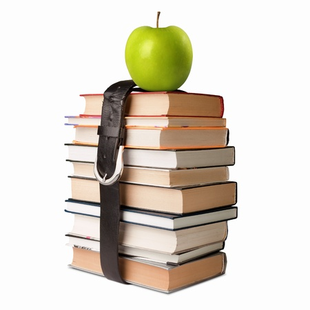 many books pile with apple and black leather belt photo