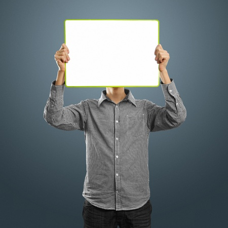 blank faces: male with write board in his hands against his head