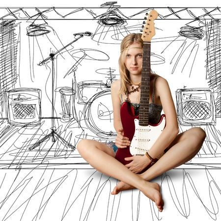 girl with the red guitar looking on camera Stock Photo