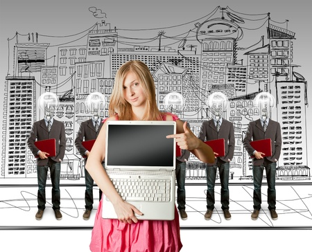 woman and lamp head businesspeople with red laptop in his hands photo