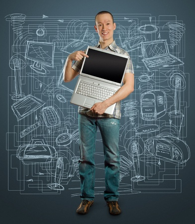 asian man with open laptop in his hands, smiles at camera Stock Photo
