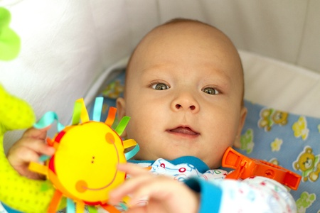 cute baby with toys in baby carriage Stock Photo - 10846062